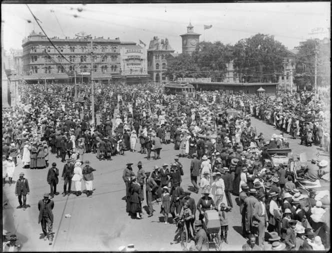 Crowd in Cathedral Square, Christchurch, celebrating Armistice Day. Head, Samuel Heath, d 1948 :Negatives. Ref: 1/1-007108-G. Alexander Turnbull Library, Wellington, New Zealand. https://natlib.govt.nz/records/22898377
